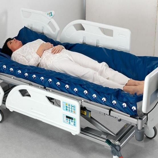 arjohuntleigh-products-therapeutic-surfaces-acute-care-active-therapy-range-nimbus-professional-deflated-mattress-on-enterprise-bed-female-patient.jpg